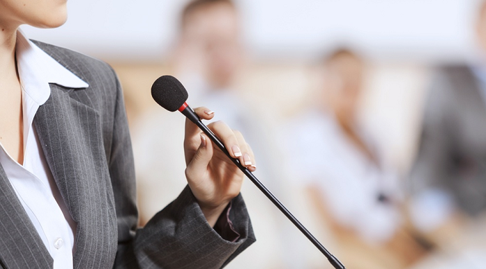 Business_Leader_at_Microphone_700_400.png